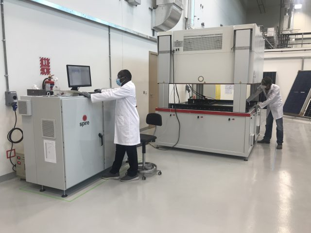 two researchers testing PV modules in a lab
