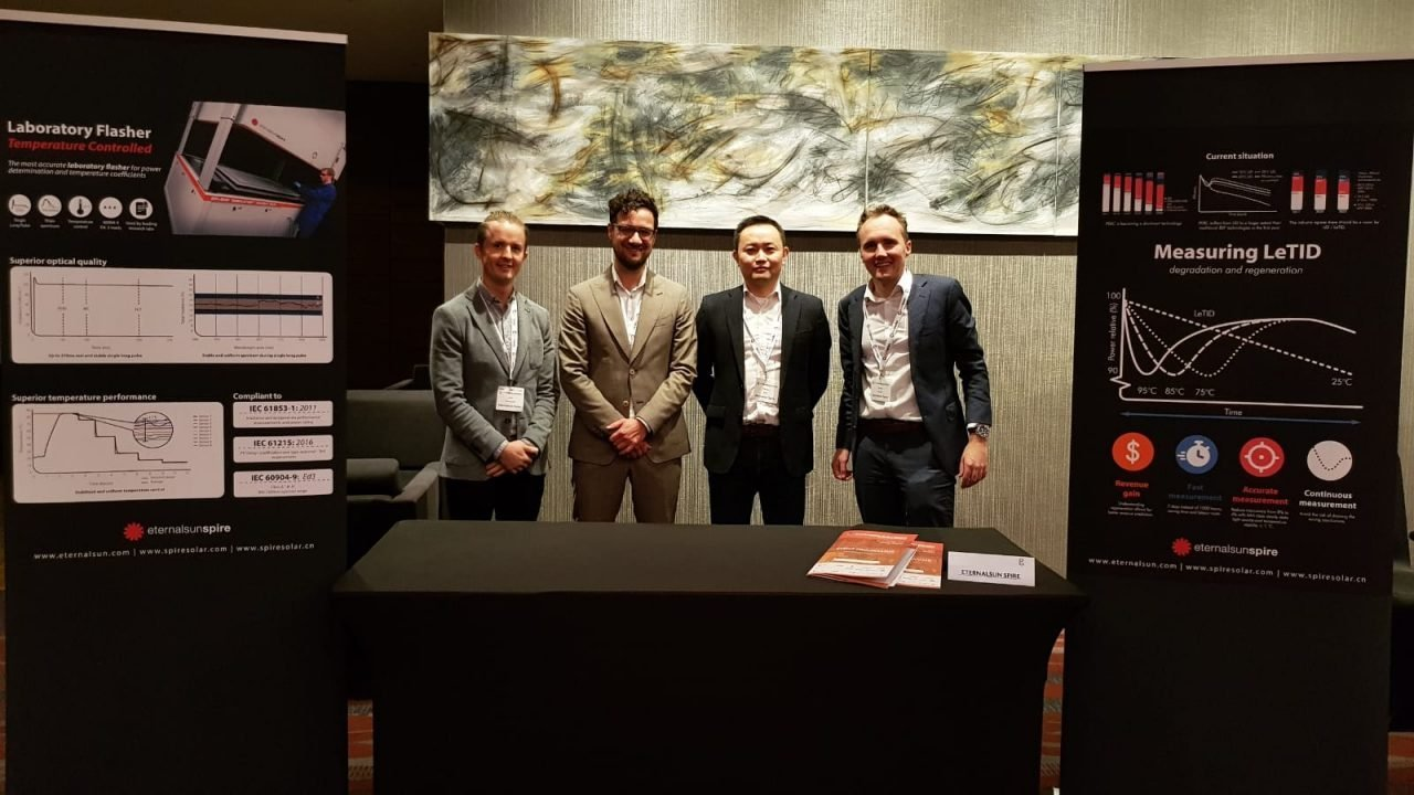 Four Eternalsun Spire employees at a booth on PV module tech conference Malaysia